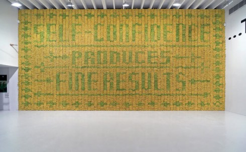 """At the opening of our exhibition at Deitch Projects in New York we featured a wall of 10,000 bananas. Green bananas created a pattern against a background of yellow bananas spelling out the sentiment: Self-confidence produces fine results.After a number of days the green bananas turned yellow too and the type disappeared."""